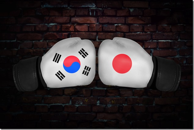 match. Confrontation between the South Korea and Japan. Republic of Korea, japanese national flags on Boxing gloves. Sports competition between the two countries. Concept foreign policy conflict.